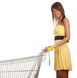 Young woman with empty shopping cart Royalty Free Stock Photography