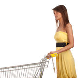 Young woman with empty shopping cart Stock Image