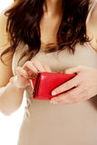 Young woman with an empty wallet. Stock Photography