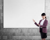 Young woman with empty white board Stock Image