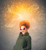 Young woman with energetic exploding red hair. Concept on background Stock Photo