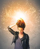 Young woman with energetic exploding red hair Royalty Free Stock Images