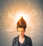 Young woman with energetic exploding red hair. Concept on background royalty free stock images