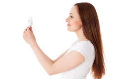 Young woman with energy efficient  lightbulb. Royalty Free Stock Image