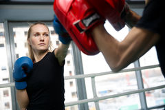 Young woman engaged in boxing Stock Image