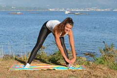 Young woman is engaged in fitness outdoors Stock Image