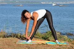 Young woman is engaged in fitness outdoors Royalty Free Stock Photography
