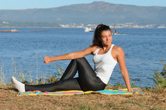 Young woman is engaged in fitness outdoors Stock Photography