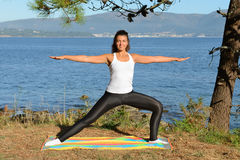 Young woman is engaged in fitness outdoors Royalty Free Stock Photo