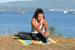 Young woman is engaged in fitness outdoors Royalty Free Stock Image