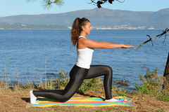 Young woman is engaged in fitness outdoors Stock Images