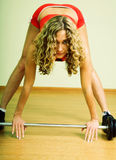 A young woman is engaged in weightlifting Royalty Free Stock Image