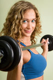 A young woman is engaged in weightlifting Royalty Free Stock Photo