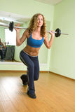 A young woman is engaged in weightlifting Royalty Free Stock Images