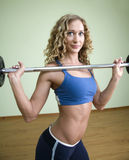 A young woman is engaged in weightlifting Royalty Free Stock Photos