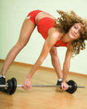 A young woman is engaged in weightlifting Stock Photo