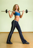 A young woman is engaged in weightlifting Stock Image