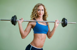 A young woman is engaged in weightlifting royalty free stock photography