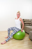 Young woman engages in aerobics Royalty Free Stock Images