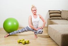young woman engages in aerobics Stock Photos