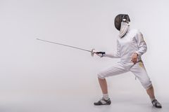 Young woman engaging in fencing Royalty Free Stock Photography