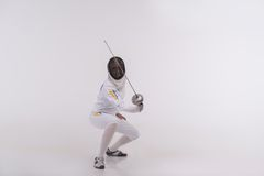 Young woman engaging in fencing Royalty Free Stock Image
