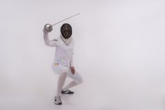 Young woman engaging in fencing Stock Photo