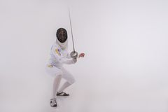 Young woman engaging in fencing Stock Image