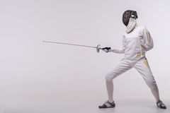 Young woman engaging in fencing Royalty Free Stock Images