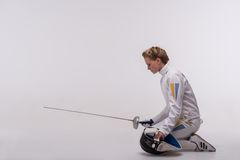 Young woman engaging in fencing Stock Photos