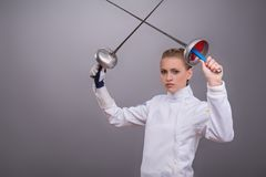 Young woman engaging in fencing Royalty Free Stock Photo