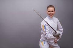 Young woman engaging in fencing Stock Images