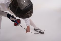 Young woman engaging in fencing Stock Photography
