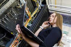 Young woman engineer at the network equipment Royalty Free Stock Images