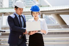 Young woman engineer was train by her mentor royalty free stock photography