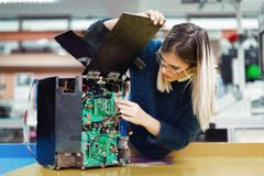 Young woman engineer working on robotics project. Young attractive woman engineer working on robotics project Royalty Free Stock Image