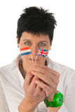 Young woman with English Dutch flags Royalty Free Stock Photography