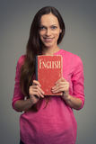 Young woman with English textbook Stock Images