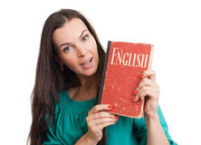 Young woman with an English textbook. Portrait of a happy young woman with an English textbook Royalty Free Stock Photos