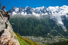 Young woman enjoing the view to Charmonix village, French Alps a. Nd glacier, France Stock Images