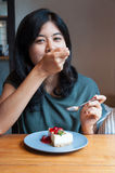Young woman enjoy with a cake in cafe Stock Photography