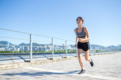 Young Woman enjoy city running. Asian young woman at outdoor Stock Image