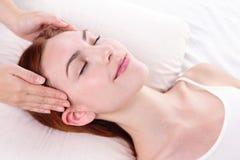 Young woman enjoy face massage Stock Photos