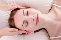 Young woman enjoy face massage Royalty Free Stock Photo