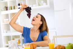 Young woman enjoy in fruits at morning time Royalty Free Stock Image