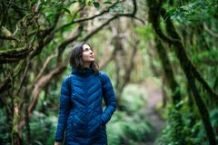 Young woman enjoy nature in laurel forest. Travel concept. Anaga Country Park, Biosphere Reserve, Tenerife, Canary islands stock images