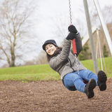 Young woman enjoy in the playground Royalty Free Stock Photo