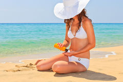 Young woman enjoy sun on the beach. Young woman enjoy sunbathing on the beach Stock Image