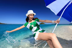 Young woman enjoy the sun. Young woman on the beach enjoy sunlight Royalty Free Stock Images