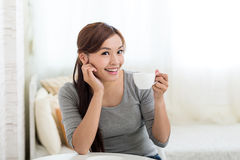 Young Woman enjoy tea Royalty Free Stock Photo